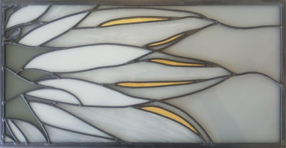 Vitral de flores con pan de oro