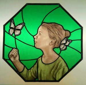Stained glass girl and butterfly