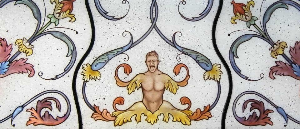 Stained Glass Window With Grotesque Detail