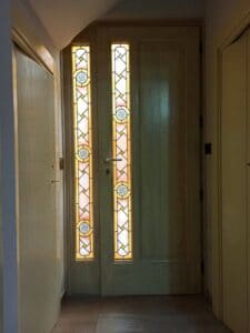 Handcrafted door with stained glass