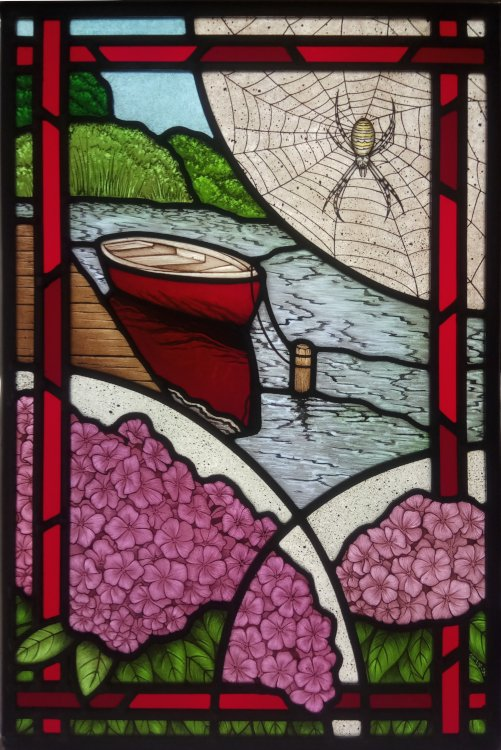 Stained glass with red boat and wasp spider