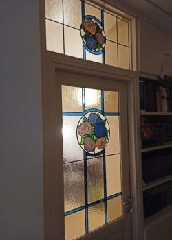 Handkrafted stained glass door with hydrangeas